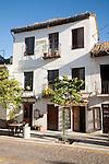 Building in historic square Placeta de San Miguel Bajo in the Albaicin district, Granada, Spain