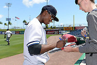 Tampa Yankees outfielder Claudio Custodio (6) signs autographs before a game against the Clearwater Threshers on April 9, 2014 at Bright House Field in Clearwater, Florida.  Tampa defeated Clearwater 5-3.  (Mike Janes/Four Seam Images)