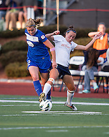 Sky Blue FC defender Caitlin Foord (4) tackles Boston Breakers forward Katie Schoepfer (12).  In a National Women's Soccer League Elite (NWSL) match, Sky Blue FC defeated the Boston Breakers, 3-2, at Dilboy Stadium on June 16, 2013