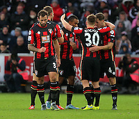 Dan Gosling of Bournemouth  (R) celebrates his goal with team mates during the Barclays Premier League match between Swansea City and Bournemouth at the Liberty Stadium, Swansea on November 21 2015