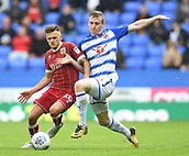 9th September 2017, Madejski Stadium, Reading, England; EFL Championship football, Reading versus Bristol City; Jamie Paterson of Bristol City and Jon Daoi Boovarsson of Reading compete for the ball