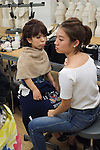 Models prepare for The International Dwarf Fashion Show in Shibuya on October 26, 2016 in Tokyo, Japan. The show featuring 6 models from all over the globe aims to show that dwarfism is a strength. The designs on display were created by NYC Label, American Wardrobe. (Photo by Michael Steinebach/AFLO)
