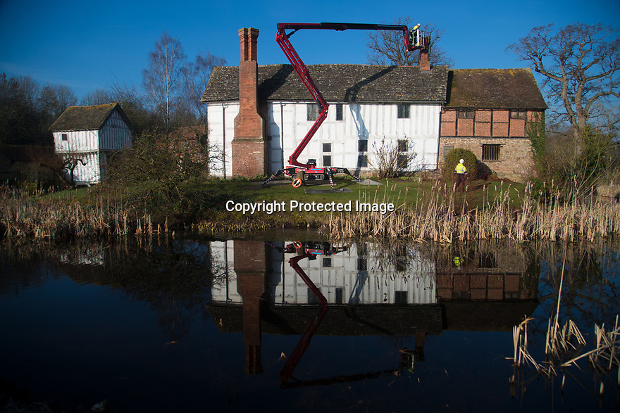 15/02/19<br /> <br /> **Free photo for editorial use**<br /> <br /> New pots are fixed to the chimneys at Lower Brockhampton the National Trust's 14th century in Herefordshire.<br /> <br /> All Rights Reserved, F Stop Press Ltd.  (0)7765 242650  www.fstoppress.com rod@fstoppress.com