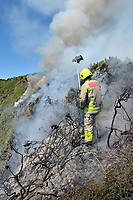 Swansea Central Firefighters called to a spreading gorse fire close to Rothslade Bay, Gower, Wales, UK<br /> Re: Grass fires taking place during warm sunny days.