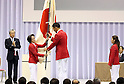July 3, 2016, Tokyo, Japan - Japan's flag bearer Keisuke Ushiro (C) receives a large national flag from Seiko Hashimoto (2nd L), head of Japanese delegation at the ceremony to form Japanese Olympic delegation for Rio de Janeiro in Tokyo on Sunday, July 3, 2016. Japanese Crown Prince Naruhito and Crown Princess Masako attended the event.  (Photo by Yoshio Tsunoda/AFLO) LWX -ytd-