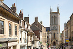 St. Michael's Church tower and buildings in Ironmonger Street, Stamford, Lincolnshire, England, UK