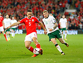 9th October 2017, Cardiff City Stadium, Cardiff, Wales; FIFA World Cup Qualification, Wales versus Republic of Ireland; James Chester (Wales) plays the ball away under pressure from James McClean (Republic of Ireland)