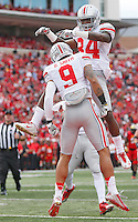 Ohio State Buckeyes wide receiver Corey Smith (84) and Ohio State Buckeyes wide receiver Devin Smith (9) celebrate Smith's 3rd quarter TD at Byrd Stadium on October 4, 2014.  (Chris Russell/Dispatch Photo)
