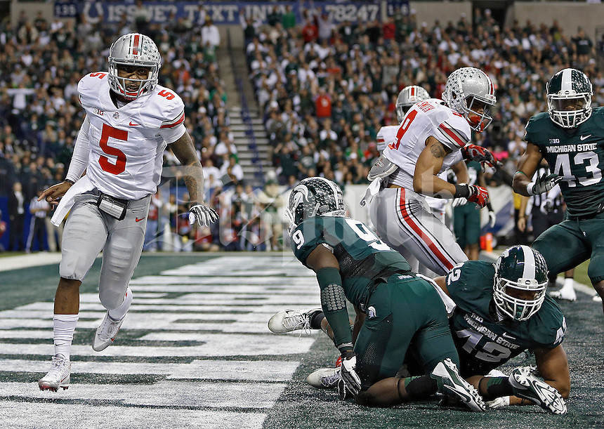 Ohio State Buckeyes quarterback Braxton Miller (5) celebrates after scoring his second rushing touchdown in the 3rd quarter against the Michigan State Spartans defense during the Big 10 Championship game at Lucas Oil Stadium in Indianapolis, Ind on December 7, 2013.  (Dispatch photo by Kyle Robertson)