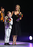 Michael Flatley' wife Niamh O'Brien and son Michael Jr with the cast onstage during the curtain call for the Broadway Opening and dedut of 'Lord of the Dance: Dangerous Games' at The Lyric Theatre on November 10, 2015 in New York City.