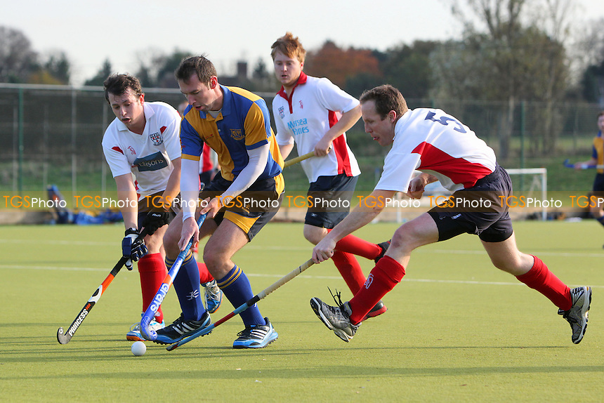 Upminster HC (yellow/blue) vs Colchester HC - East Mens Hockey League Division One at Coopers Company & Coborn School - 16/11/13 - MANDATORY CREDIT: Gavin Ellis/TGSPHOTO - Self billing applies where appropriate - 0845 094 6026 - contact@tgsphoto.co.uk - NO UNPAID USE