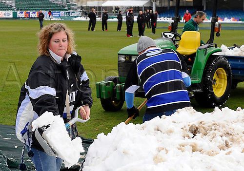 18.12.2010 Heineken Cup Rugby from the Recreation Ground. Pool 4 game Bath v Ulster Dec 18th.  Volunteering supporters clear snow from the pitch at 'The Rec' to ensure the match will be played.