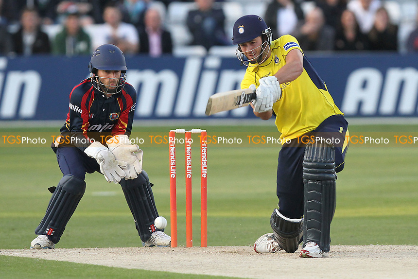 James Vince of Hampshire hits out as James Foster looks on - Essex Eagles vs Hampshire Royals - Friends Life T20 Cricket at the Ford County Ground, Chelmsford, Essex - 29/06/12 - MANDATORY CREDIT: Gavin Ellis/TGSPHOTO - Self billing applies where appropriate - 0845 094 6026 - contact@tgsphoto.co.uk - NO UNPAID USE.