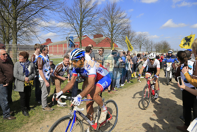 The peloton including William Bonnet (FRA) FDJ tackle Sector 10 Mons-en-Pevele during the 113th edition of the Paris-Roubaix 2015 cycle race held over the cobbled roads of Northern France. 12th April 2015.<br /> Photo: Eoin Clarke www.newsfile.ie