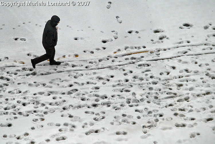 Man makes his way through the snow and freezy temperatures this morning Dec. 16 2007  along Columbus Ave. in Manhattan.
