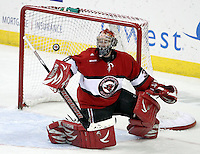 UNO goalie John Faulkner steers aside a shot during the third period..No. 4 UNO beat No. 7 North Dakota 1-0 Saturday night at Qwest Center Omaha. (Photo by Michelle Bishop)