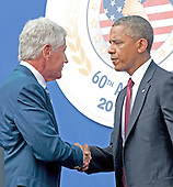 United States Secretary of Defense Chuck Hagel shakes hands with U.S. President Barack Obama prior to the President's remarks marking the 60th Anniversary of the Korean War Armistice at the Korean War Veterans Memorial in Washington, D.C. on Saturday, July 27, 2013.<br /> Credit: Ron Sachs / Pool via CNP