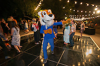 Alumni Reunion Weekend, Saturday, June 21, 2014. Oswald has some fun at the moonlight casino, dance and lounge after-party. (Photo by Marc Campos, Occidental College Photographer)