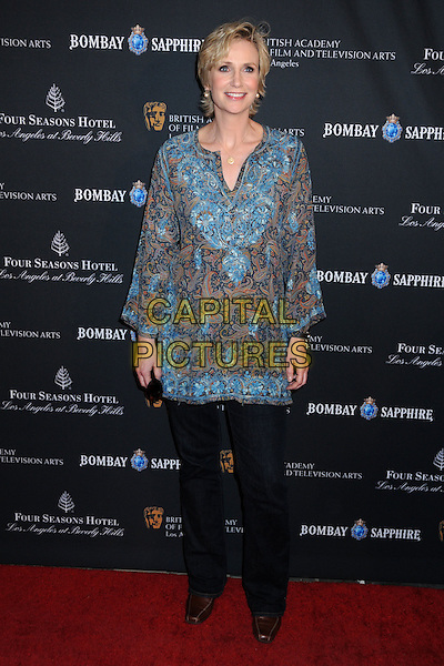 JANE LYNCH.17th Annual BAFTA Los Angeles Awards Season Tea Party held at the Four Seasons Hotel, Beverly Hills, California, USA, 15th January 2011..full length tunic top trousers black green print gold necklace blue .CAP/ADM/BP.©Byron Purvis/AdMedia/Capital Pictures.