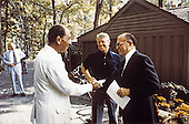 President Anwar al-Sadat of Egypt, left, shakes hands with Prime Minister Menachem Begin of Israel, right, as United States President Jimmy Carter, center, looks on 06 September 1978 at Camp David, the US presidential retreat near Thurmont, Maryland prior to their meeting on September 6, 1978..Mandatory Credit: Karl Schumacher - White House via CNP