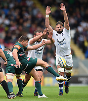 Ben Youngs of Leicester Tigers box-kicks the ball as Tom Dunn and Elliott Stooke of Bath Rugby look to charge him down. Aviva Premiership match, between Leicester Tigers and Bath Rugby on September 3, 2017 at Welford Road in Leicester, England. Photo by: Patrick Khachfe / Onside Images