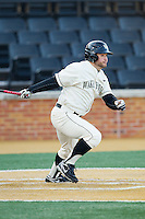Nate Mondou (10) of the Wake Forest Demon Deacons follows through on his swing against the Towson Tigers at Wake Forest Baseball Park on February 15, 2014 in Winston-Salem, North Carolina.  The Tigers defeated the Demon Deacons 5-4.  (Brian Westerholt/Four Seam Images)