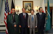 New York, NY - September 12, 2002 -- United States President George W. Bush poses for a group photo with, from left, President of Afghanistan Hamid Karzai, Japanese Prime Minister Junichiro Koizumi and Saudi Arabian Foreign Minister Prince Saud al-Faisal at the Waldorf-Astoria Hotel in New York City, Thursday, September 12, 2002. The leaders announced a joint project to provide $180 million for road improvements in Afghanistan. <br /> Mandatory Credit: Eric Draper / White House via CNP