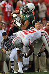 Oregon wide receiver Lavasier Tuinei is knocked out of bounds by Ohio State's Anderson Russell in the 96th Rose Bowl in Pasadena, Ca January 1, 2010.