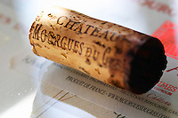 Close-up of a cork with the text stamped on it lying on top of a label. Chateau Mourgues du Gres Grès, Costieres de Nimes, Bouches du Rhone, Provence, France, Europe