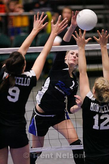 Trent Nelson  |  The Salt Lake Tribune.Rich's Lynzee Wallentine spikes the ball with Monticello's Swayzi Slade (9) and Devin Dalton on the block. Rich vs Monticello for the 1A high school State Championship at Utah Valley University in Orem, UT on Saturday, October 29, 2011.