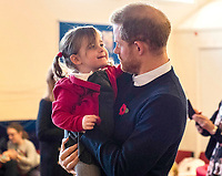 06/11/2019 - Poppy Dean being held by Prince Harry Duke of Sussex, during a visit to Broom Farm Community Centre in Windsor. The Duke and Duchess of Sussex attended a coffee morning with families of deployed Army personnel at the Centre. Photo Credit: ALPR/AdMedia