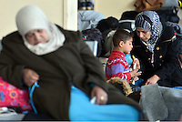 Pictured: Migrants of all ages take shelter at the passenger terminal in Piraeus port, Greece Sunday 28 February 2016<br /> Re: Hundreds of migrants have arrived from the Greek islands to Piraeus Port, Greece