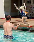 SOUTHBURY, CT--- -070515JS03--Jane Light, 6, of Roxbury jumps into the arms of her father Matthew Light while enjoying a sunny day Sunday at the Southbury town swimming pool at Ballatine Park in Southbury. <br /> Jim Shannon Republican-American