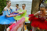 Classical Ballet performers from the Stetson Academy of Dance in DeLand (left to right) Nicky Chute (blue), Kelsey Chute (purple), Sarah Oepen (green), and Amber Young (red) get ready to perform Saturday, March 22, 2003, during the Youth Celebration of the Arts by the DeBary Art League and Volusia County Leisure Services at Gemini Springs Park in DeBary. (Chad Pilster)