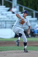 Helmis Rodriguez #33 of the Tri-City Dust Devils pitches against the Everett AquaSox at Everett Memorial Stadium on July 29, 2014 in Everett, Washington. Everett defeated Tri-City, 7-5. (Larry Goren/Four Seam Images)