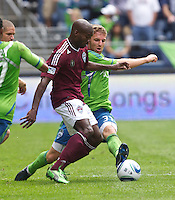 Seattle Sounders FC defender Jeff Parke tries to get the ball from Colorado Rapids midfielder Omar Cummings during play at CenturyLink Field in Seattle Saturday July 17, 2011. The Sounders won the game 4-3.