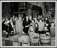 BNPS.co.uk (01202 558833)<br /> Pic: RRAuction/BNPS<br /> <br /> JFK campaigning in front of a market in the Italian neighborhood in East Boston during the 1952 race for the Senate.<br /> <br /> Incredibly-rare photos highlighting the first foray into politics for John F. Kennedy that would eventually cost him his life have come to light.<br /> <br /> The 100 black and white snaps show a youthful-looking JFK from 1946, when he was campaigning to become a US congressman for the first time.<br /> <br /> The tragic future president is seen during an oration lesson where he was given help by an expert with public speaking and posture.<br /> <br /> The 29-year-old is also depicted mingling with the public at an annual parade and as well as celebrating his first political victory - a congressional primary vote - in June 1946.<br /> <br /> The images are being sold by US-based RR Auction.