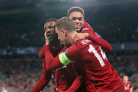 Liverpool's Georginio Wijnaldum (left) is mobbed by Jordan Henderson (right) and Trent Alexander-Arnold as he celebrates scoring his side's third goal <br /> <br /> Photographer Rich Linley/CameraSport<br /> <br /> UEFA Champions League Semi-Final 2nd Leg - Liverpool v Barcelona - Tuesday May 7th 2019 - Anfield - Liverpool<br />  <br /> World Copyright © 2018 CameraSport. All rights reserved. 43 Linden Ave. Countesthorpe. Leicester. England. LE8 5PG - Tel: +44 (0) 116 277 4147 - admin@camerasport.com - www.camerasport.com