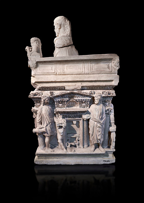 """End panel of a Roman relief sculpted sarcophagus with kline couch lid with a reclining male figuer depicted, """"Columned Sarcophagi of Asia Minor"""" style typical of Sidamara, 3rd Century AD, Konya Archaeological Museum, Turkey. Against a black background"""