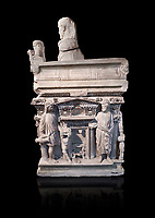 "End panel of a Roman relief sculpted sarcophagus with kline couch lid with a reclining male figuer depicted, ""Columned Sarcophagi of Asia Minor"" style typical of Sidamara, 3rd Century AD, Konya Archaeological Museum, Turkey. Against a black background"