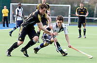 Toby Roche (R) attempts to stop a Beeston player during the HA Mens Cup Semi-Final between Hampstead & Westminster and Beeston at the Paddington Recreation Ground, Maida Vale on Sun March 20, 2011