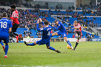 Lee Cattermole of Sunderland shoots under pressure from Jazz Richards and Sean Morrison of Cardiff City during the Sky Bet Championship match between Cardiff City and Sunderland at the Cardiff City Stadium, Cardiff, Wales on 13 January 2018. Photo by Mark  Hawkins / PRiME Media Images.