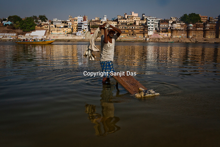 A washerman seen working on the banks of river Ganges in the ancient city of Varanasi in Uttar Pradesh, India. Photograph: Sanjit Das/Panos