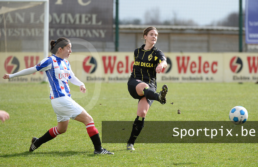 20140315 - WESTERLO , BELGIUM : Lierse Evelien Stoffels (r) pictured with Heerenveen Hau Si SHut (l) during the soccer match between the women teams of SK Lierse Dames  and SC Heerenveen Vrouwen , on the 19th matchday of the BeNeleague competition Saturday 15 March 2014 in Westerlo . PHOTO DAVID CATRY