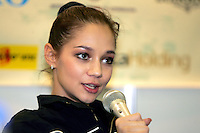 Irina Tchachina of Russia answers press conference questions after clubs and ribbon event finals and team awards at World Championships at Baku, Azerbaijan on October 6, 2005.  At the October 8th press interview, Irina commented that she has plenty of power along with the other AA medalists to continue in RG... Photo by Tom Theobald.