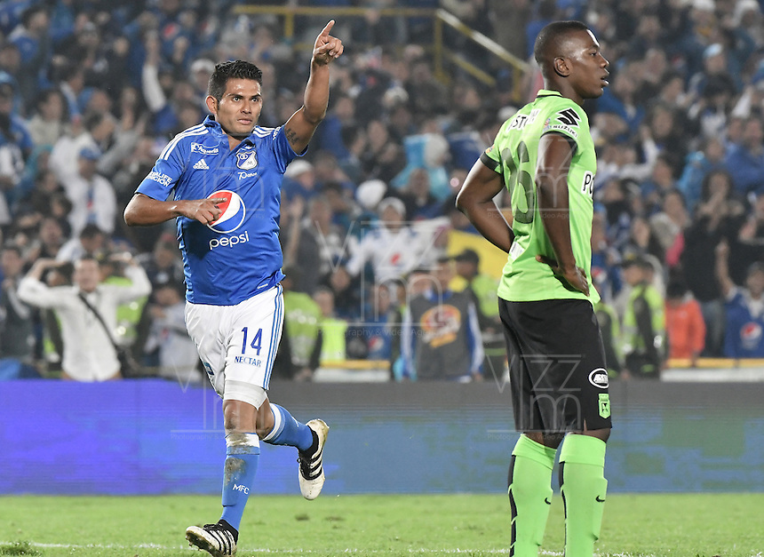 BOGOTA - COLOMBIA -27 -11-2016: David Silva de Millonarios celebra después de anotar un gol a Atlético Nacional durante partido de ida por los cuartos de final de la Liga Aguila II 2016 jugado en el estadio Nemesio Camacho El Campin de la ciudad de Bogota. / David Silva of Millonarios celebrates after scoring a goal to Atletico Nacional during first leg match for the final quarters of the Liga Aguila II 2016 played at the Nemesio Camacho El Campin Stadium in Bogota city. Photo: VizzorImage / Gabriel Aponte / Staff.