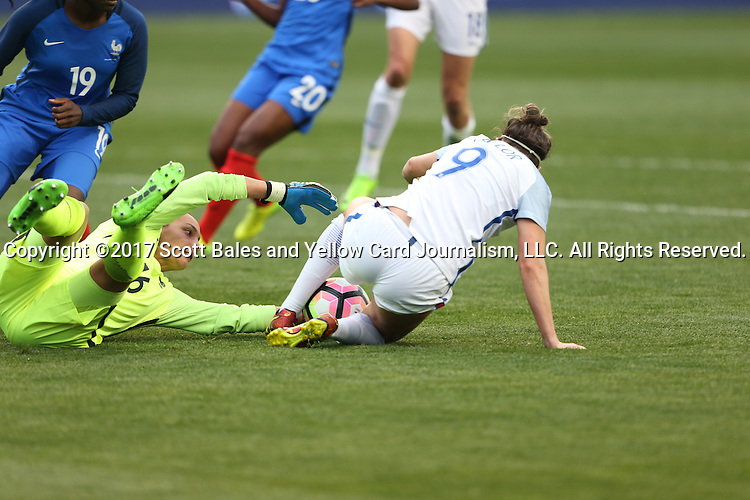 CHESTER, PA - MARCH 01: Jodie Taylor (ENG) (9) tries to strip the ball from Sarah Bouhaddi (FRA) (16). The England Women's National Team played the France Women's National Team as part of the She Believes Cup on March, 1, 2017, at Talen Engery Stadium in Chester, PA. The France won the game 2-1.