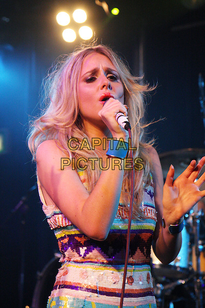 DIANA VICKERS.Performing live at the Scala, London, England..May 12th, 2010.stage concert live gig performance music half length white purple blue yellow pattern print tribal dress singing  blue cuff bracelets .CAP/MAR.© Martin Harris/Capital Pictures.
