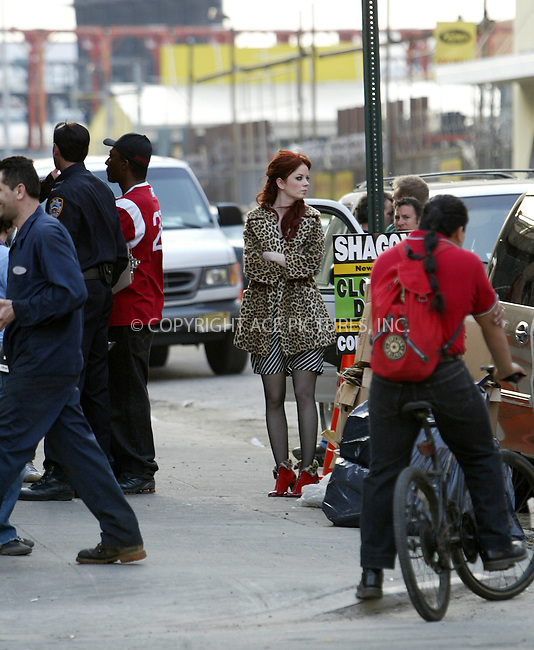 WWW.ACEPIXS.COM . . . . .***EXCLUSIVE!!! FEE MUST BE NEGOTIATED BEFORE USE!!!***....NEW YORK, APRIL 20, 2005....Shirley Manson is seen on the set of the new Garbage video being shot in midtown Manhattan's west side. Shirley Manson takes the down time to eat a burger, grab a cardigan from her limo and watch her body double from the back of a van. As day turns to night on the set, we see her bodyguard, dressed as a New York Police Officer, escort her to a local deli for some snacks.....Please byline: Ian Wingfield - ACE PICTURES..... *** ***..Ace Pictures, Inc:  ..Craig Ashby (212) 243-8787..e-mail: picturedesk@acepixs.com..web: http://www.acepixs.com