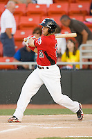 Michael Ortiz #21 of the Hickory Crawdads follows through on his swing against the Greenville Drive at  L.P. Frans Stadium May 8, 2010, in Hickory, North Carolina.  Photo by Brian Westerholt / Four Seam Images